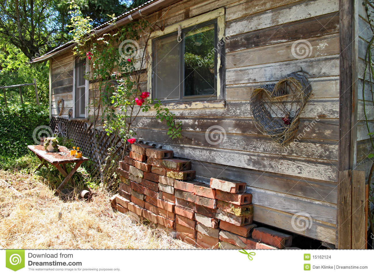 Old wood cabin in the woods stock images image 15162124 for Cabin in the woods oregon