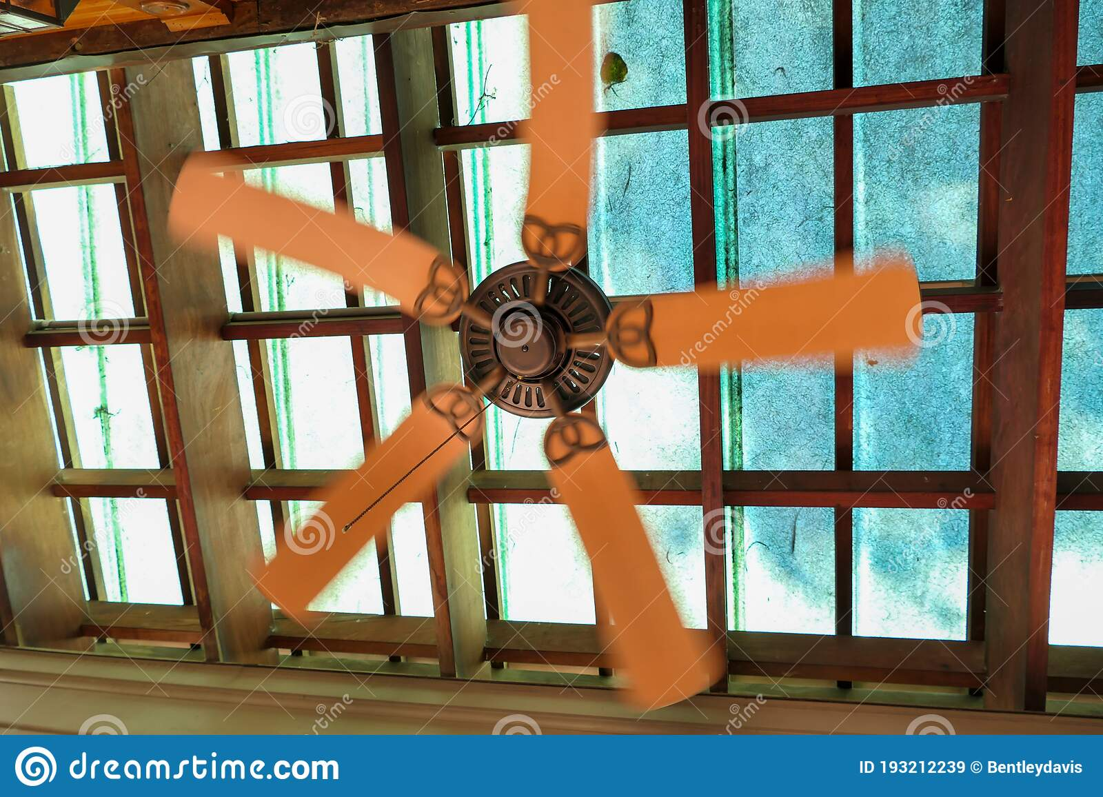 An Old Ceiling Fan On A Skylight Stock Image Image Of Spinning Home 193212239