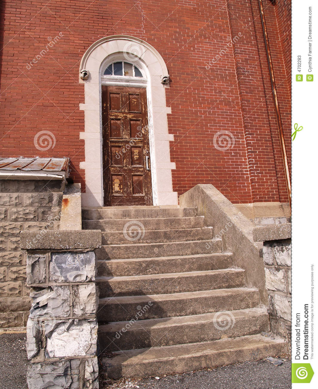 Old Brick Apartment Building: Old Wood Door By A Red Brick Building Stock Image