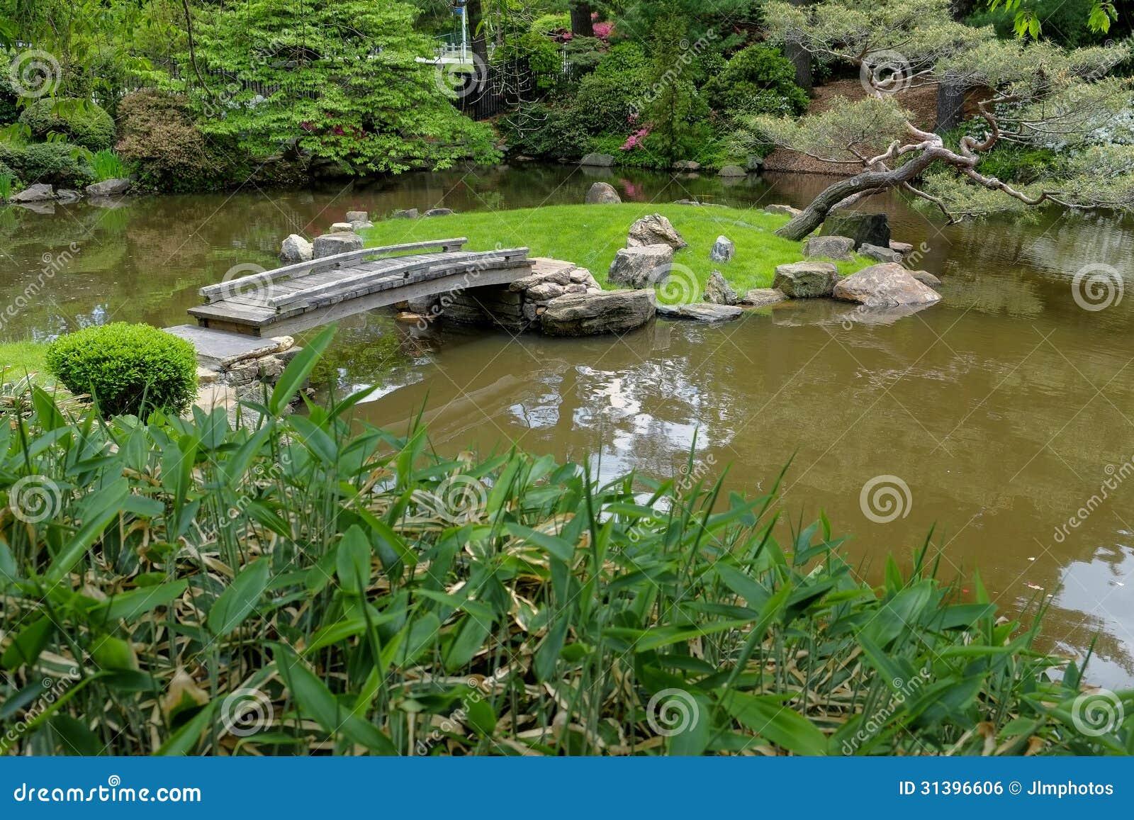 Old Wood Foot Bridge Across A Koi Pond