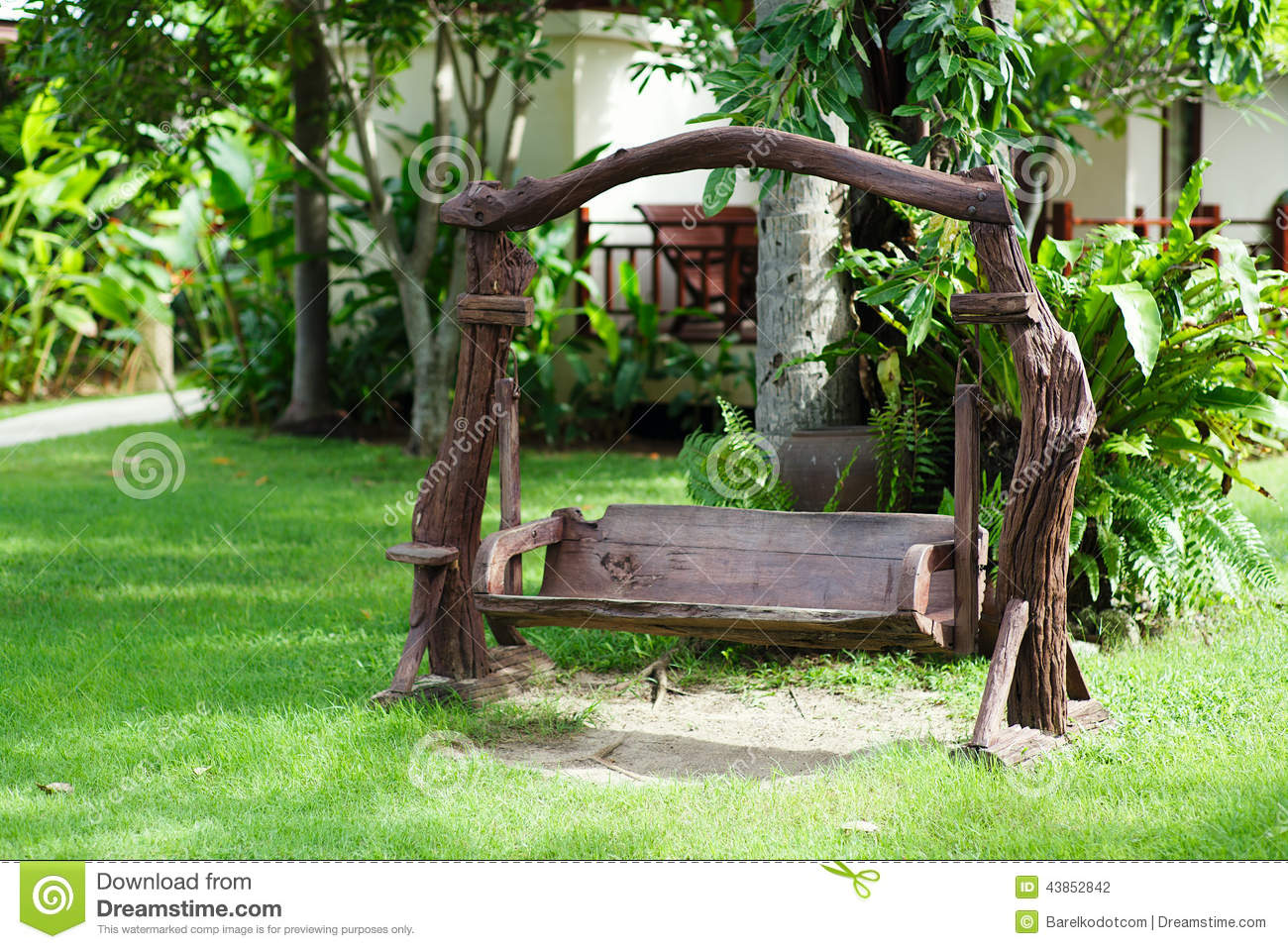 old wood swing in the green garden stock photo image 43852842