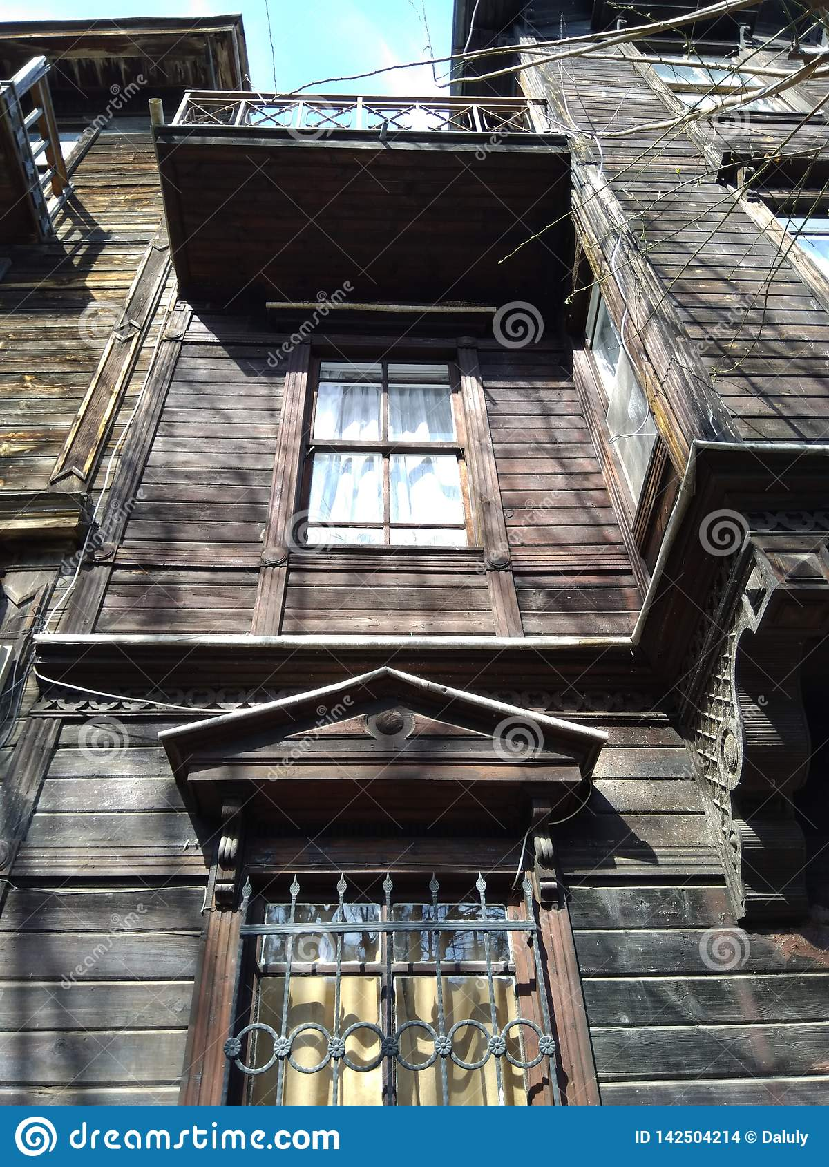 Old wooden abandoned house close up with many decorative details