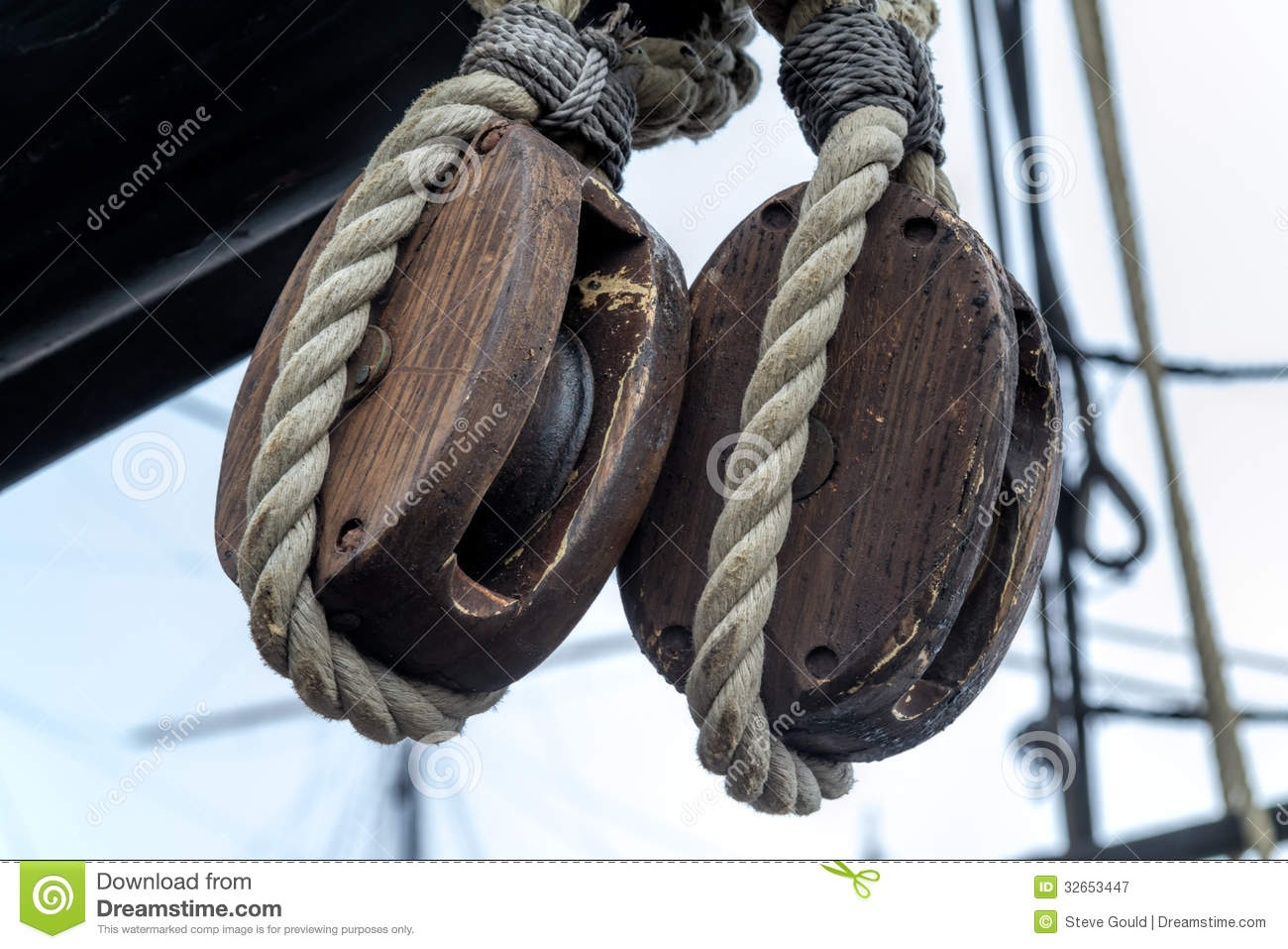Old wooden block pulleys and rope