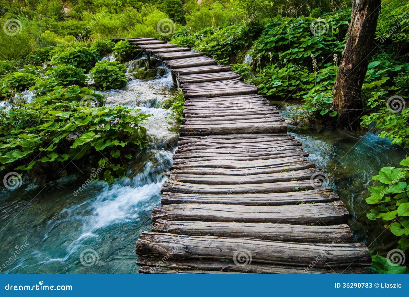 Old Wooden Bridge Over River Stock Image - Image of bridge ...