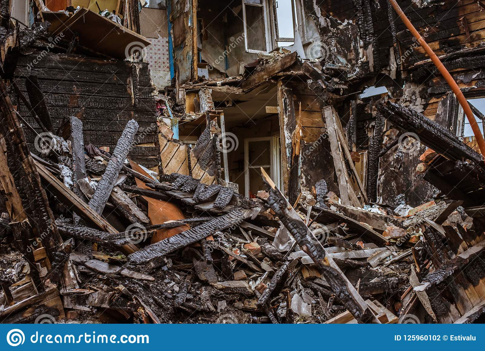 The Old Wooden Burned-down House A View From Inside Stock Photo