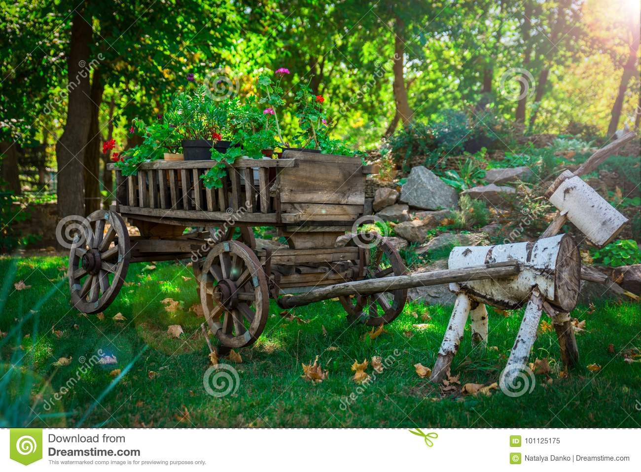 Old Wooden Cart With Wheels With Flower Pots Stock Image
