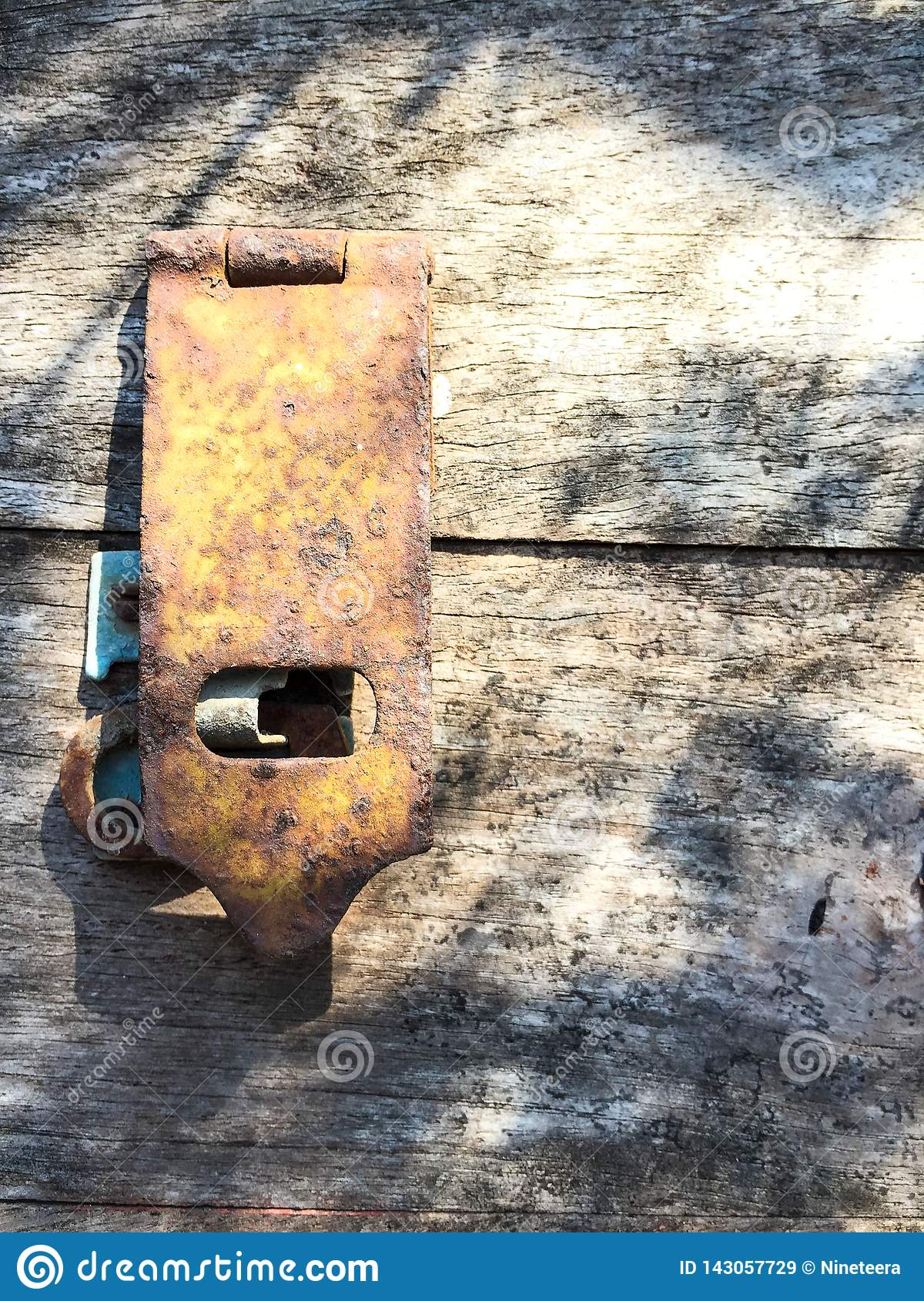 Old wooden chest with rusty padlock