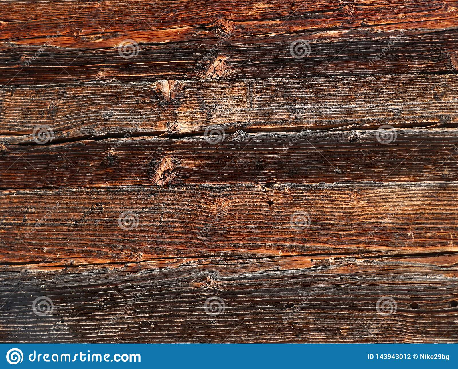 Old wooden dark plank texture as a background