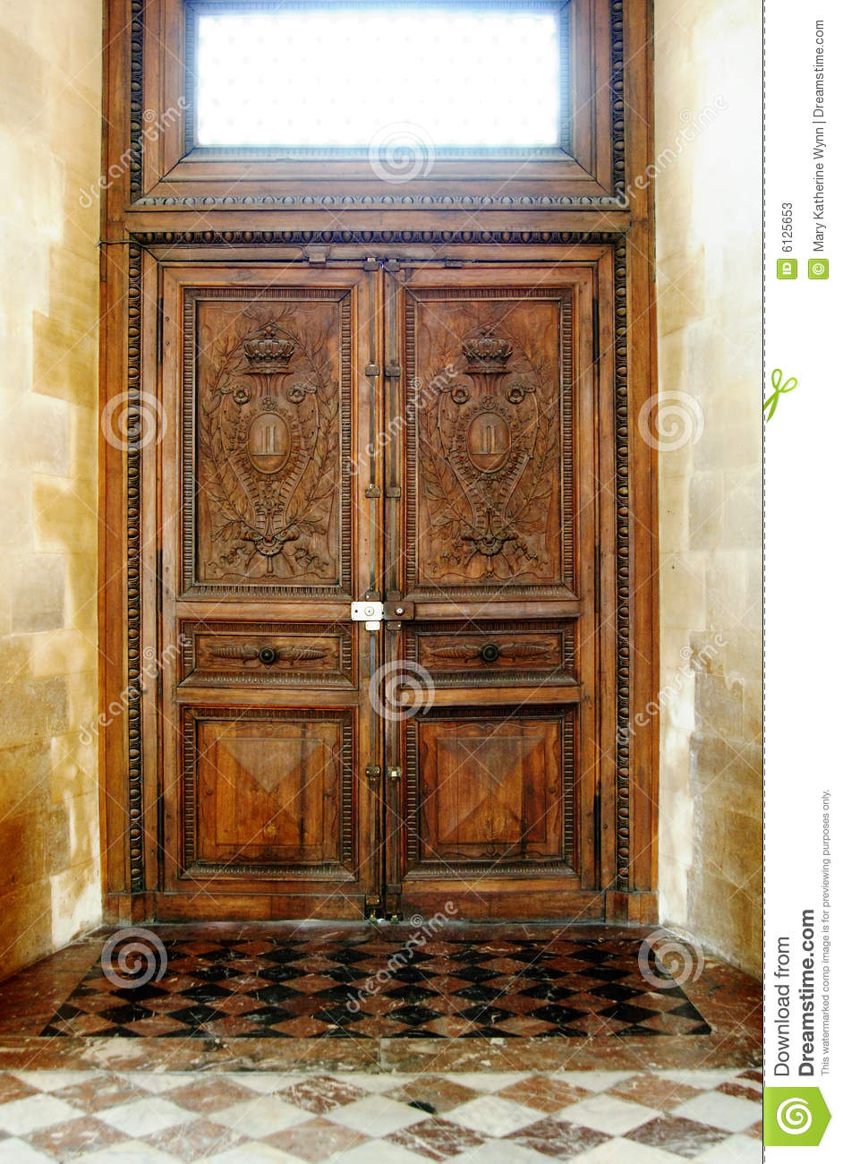 Old wooden door clipart -  View Of An Old Wooden Door With A Window Above It Inside A House