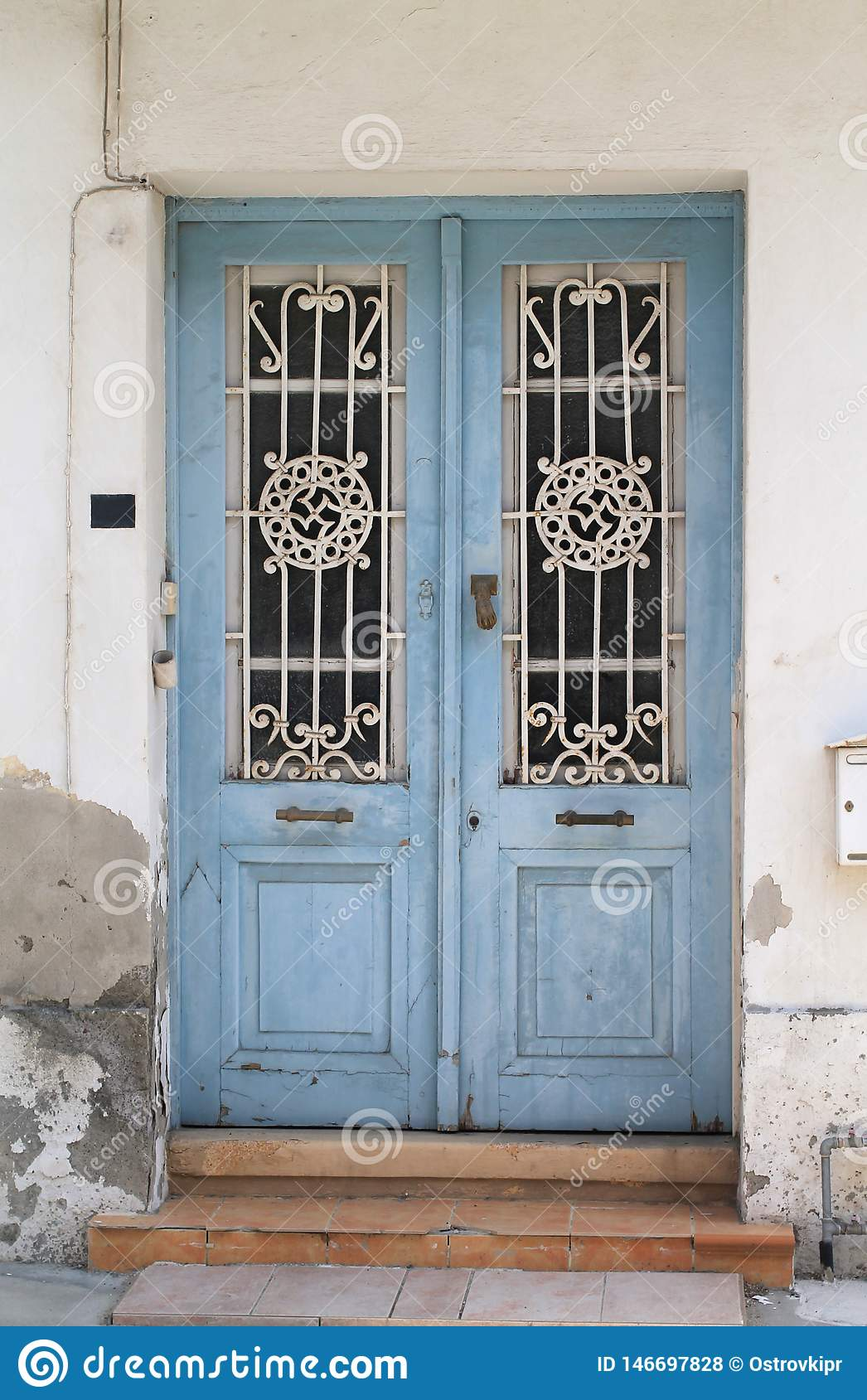 Old Wooden Door With Glass Panels And Metal Grates Stock Photo Image Of Metal Weathered 146697828