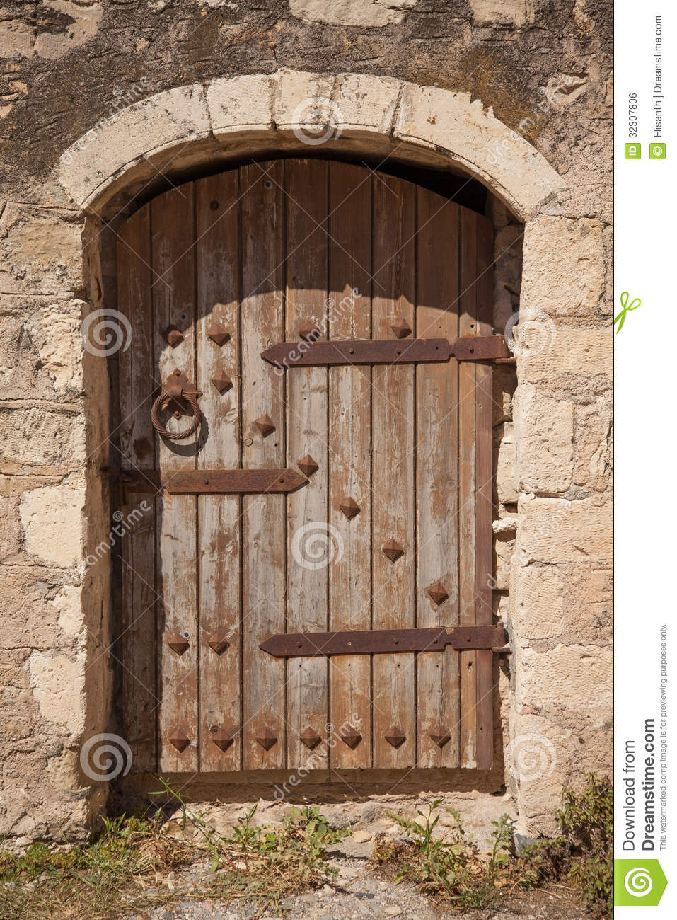 Old Wooden Door With Metal Decor