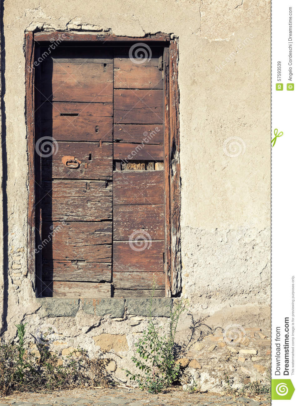 Old wooden door on stone wall of a house stock photo for Door of stone