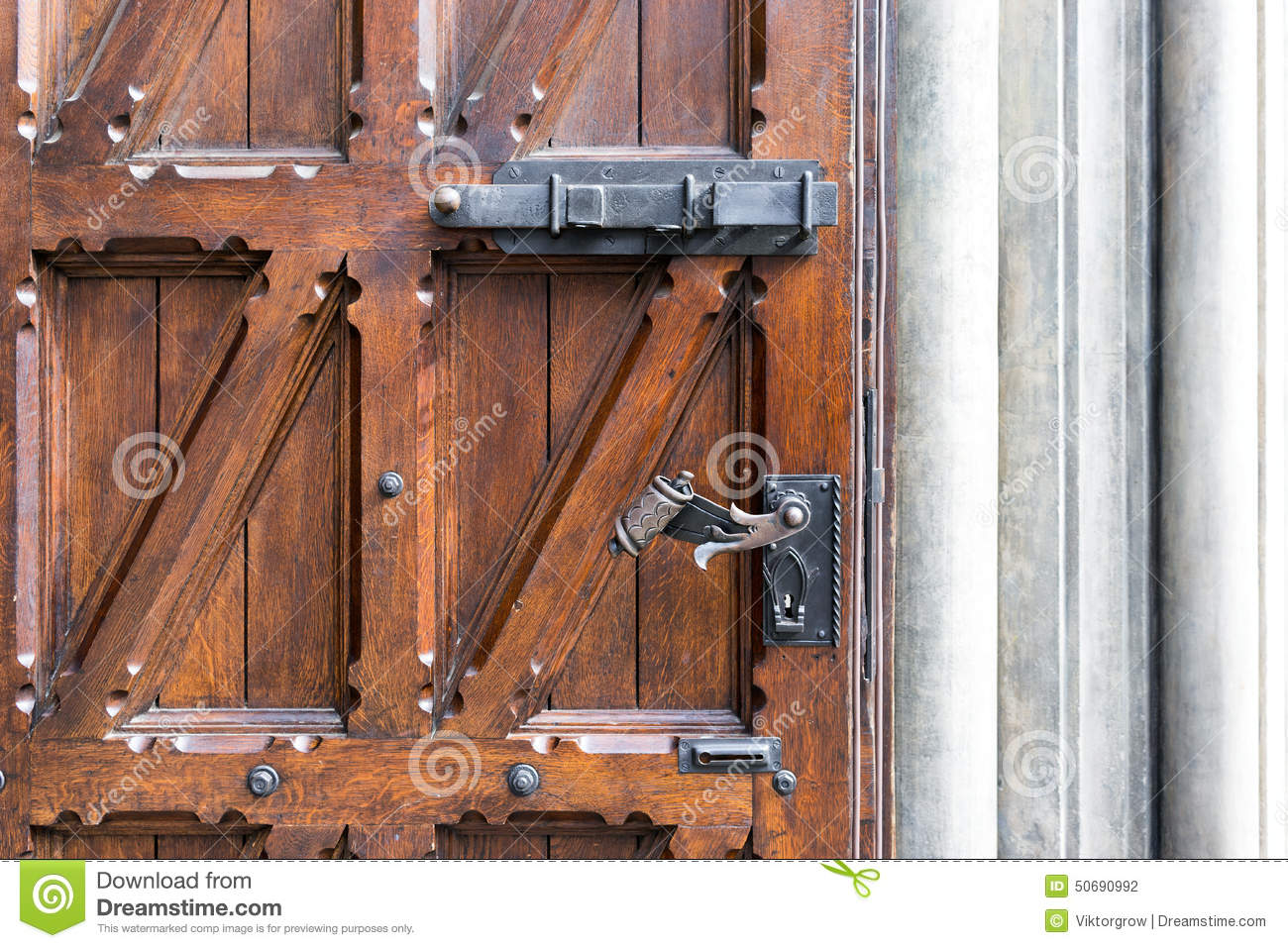 957 #945937 Old Wooden Door With Wrought Iron Handle Stock Photo Image: 50690992 image Wrought Iron And Wood Doors 40031300