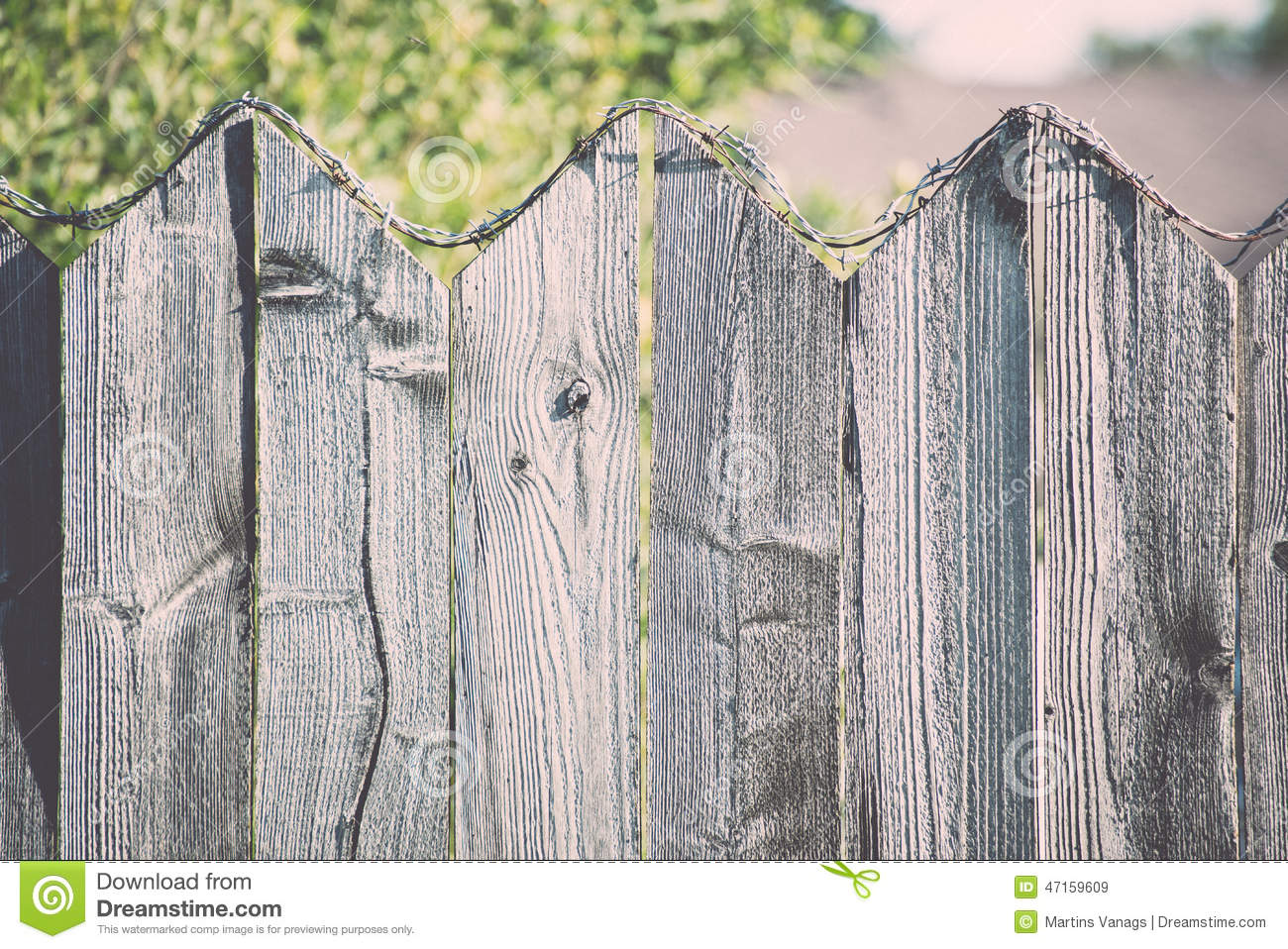 Old wooden fence with barbed wire on top vintage stock photo barbed fence old wire wooden baanklon Choice Image
