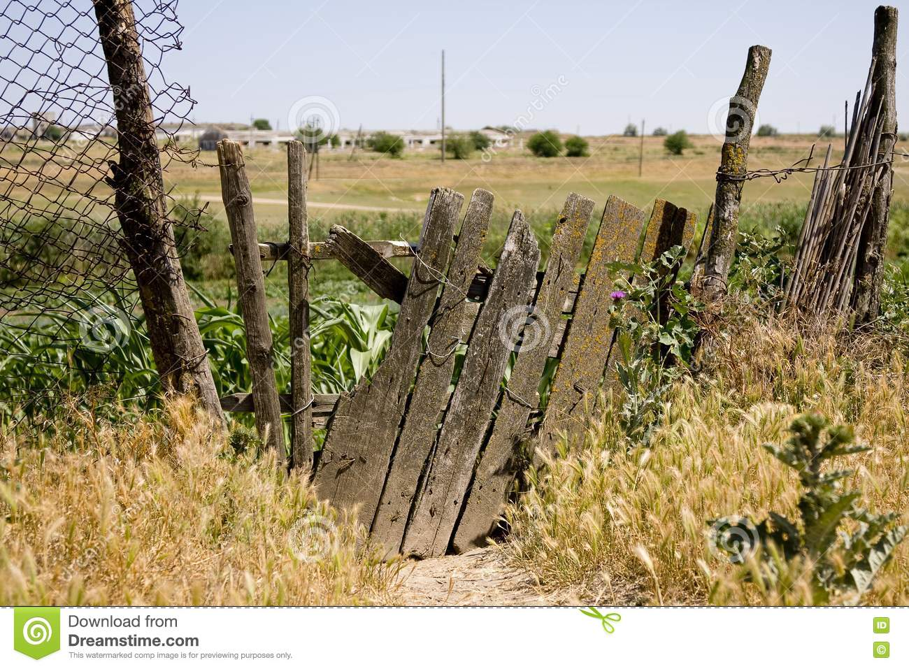 Old wooden fence on the thrown farm stock photo image