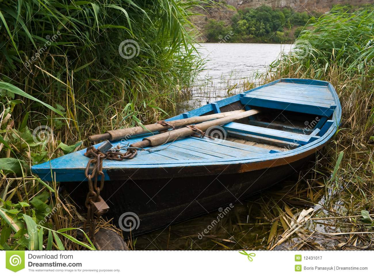 Old wooden fishing boat stock image. Image of reeds, fishing - 12431017