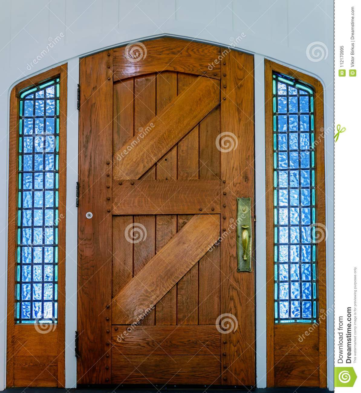 Old Wooden Front Door Of Planks With A Metal Handle And Glass Wi