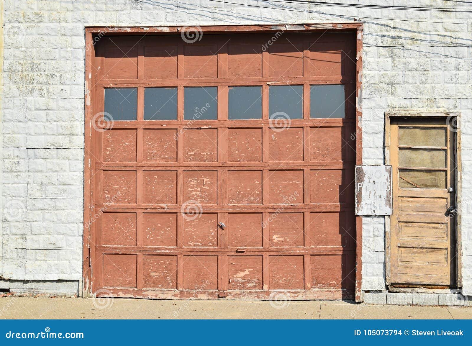 Wooden Garage Door With Small Door Stock Photo Image Of Property