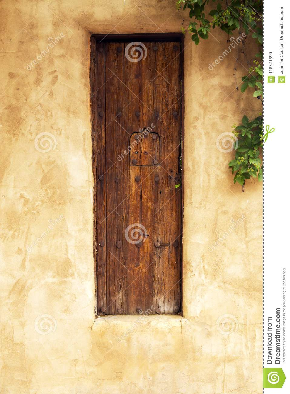 Old Wooden Gate With Security Window In Santa Fe New Mexico Stock