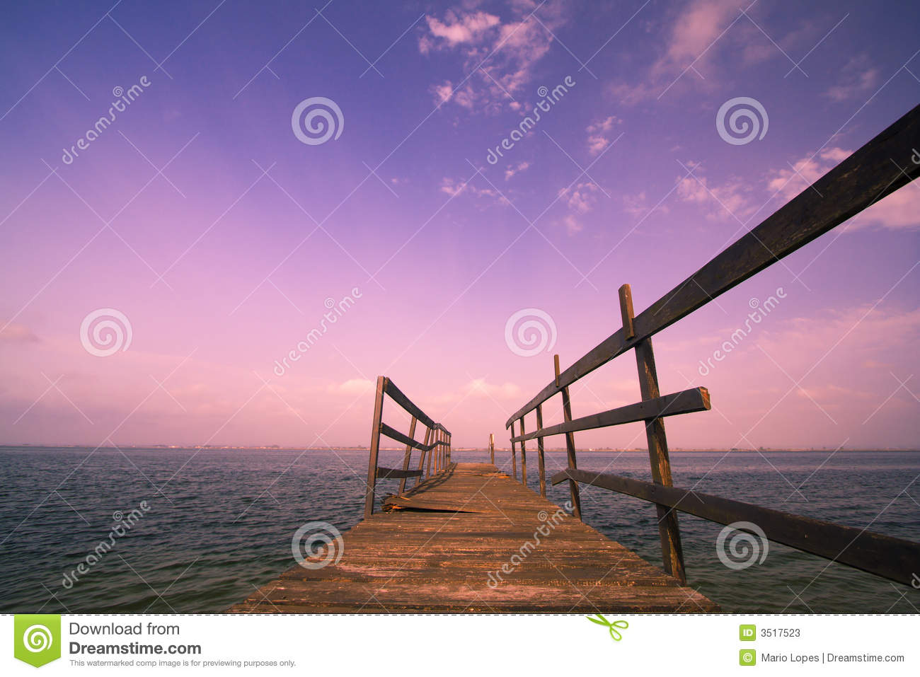 Old wooden harbor at sunset
