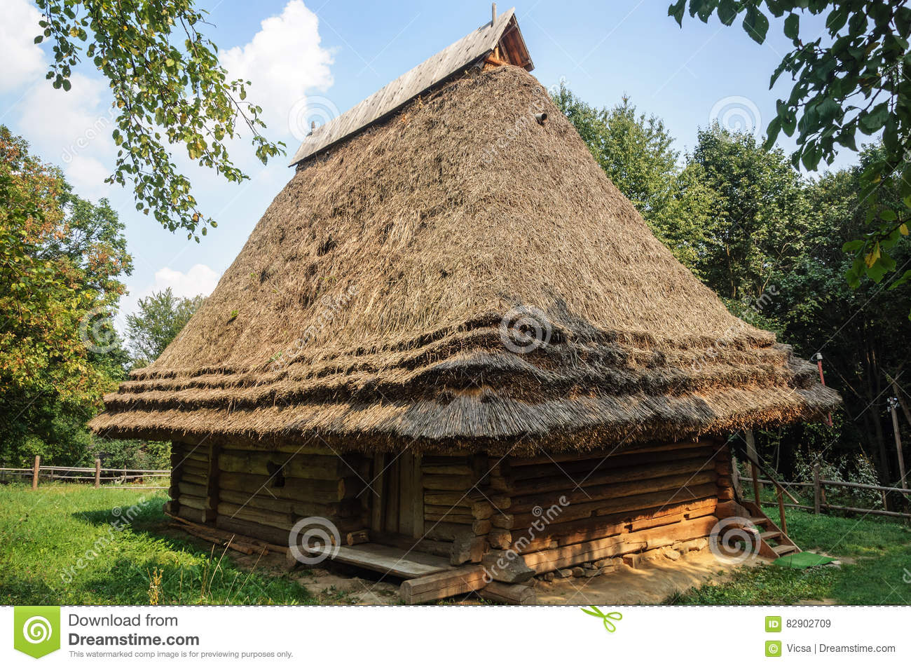 Old Wooden House With Straw Roof