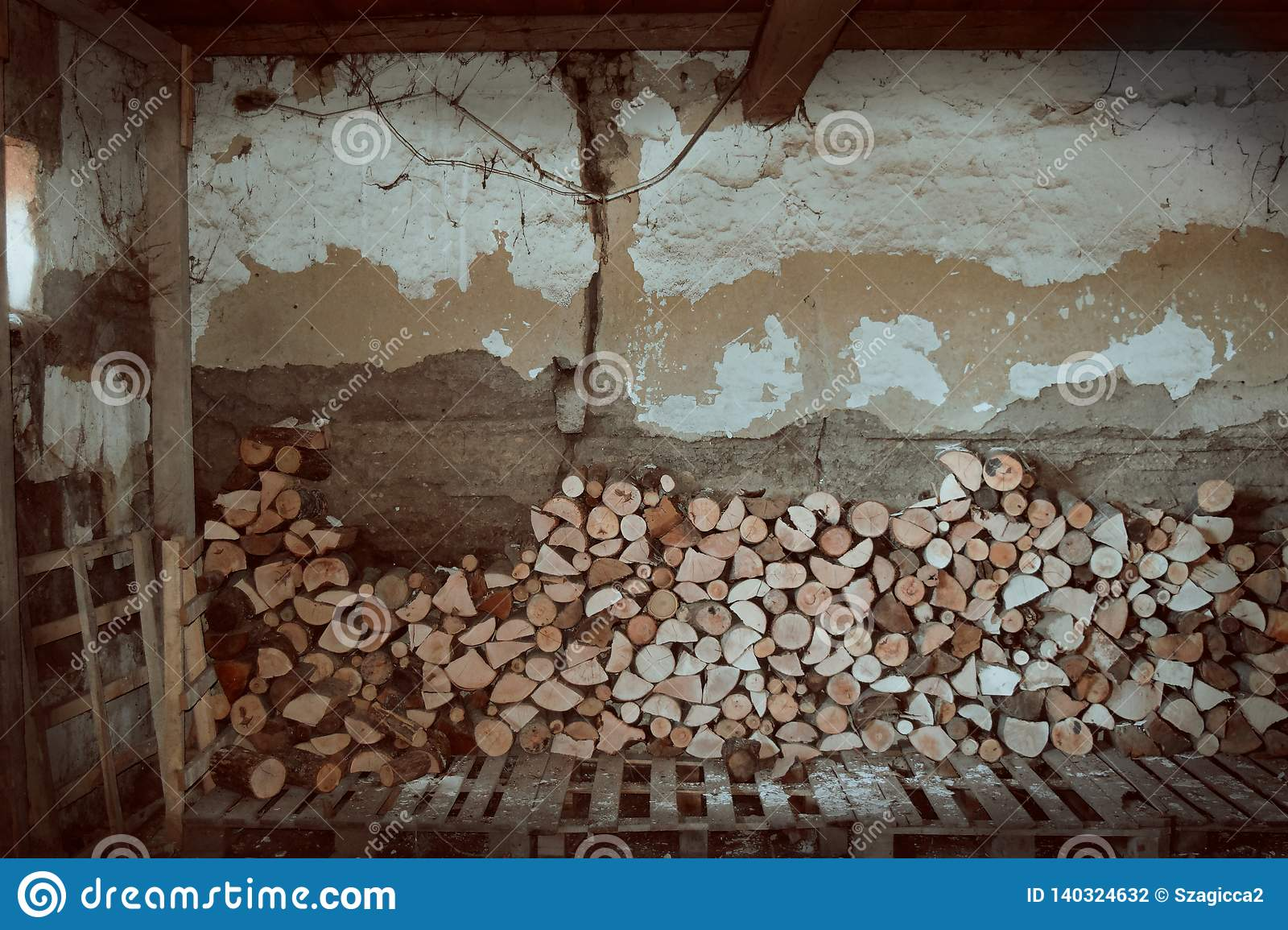 Firewood and old house indoor in Serbia, Subotica