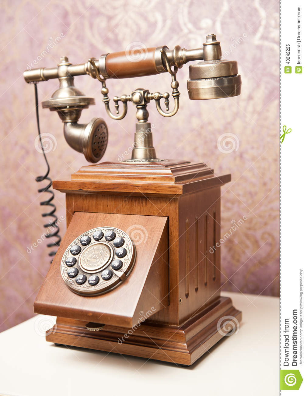 Old wooden phone vintage telephone on white table