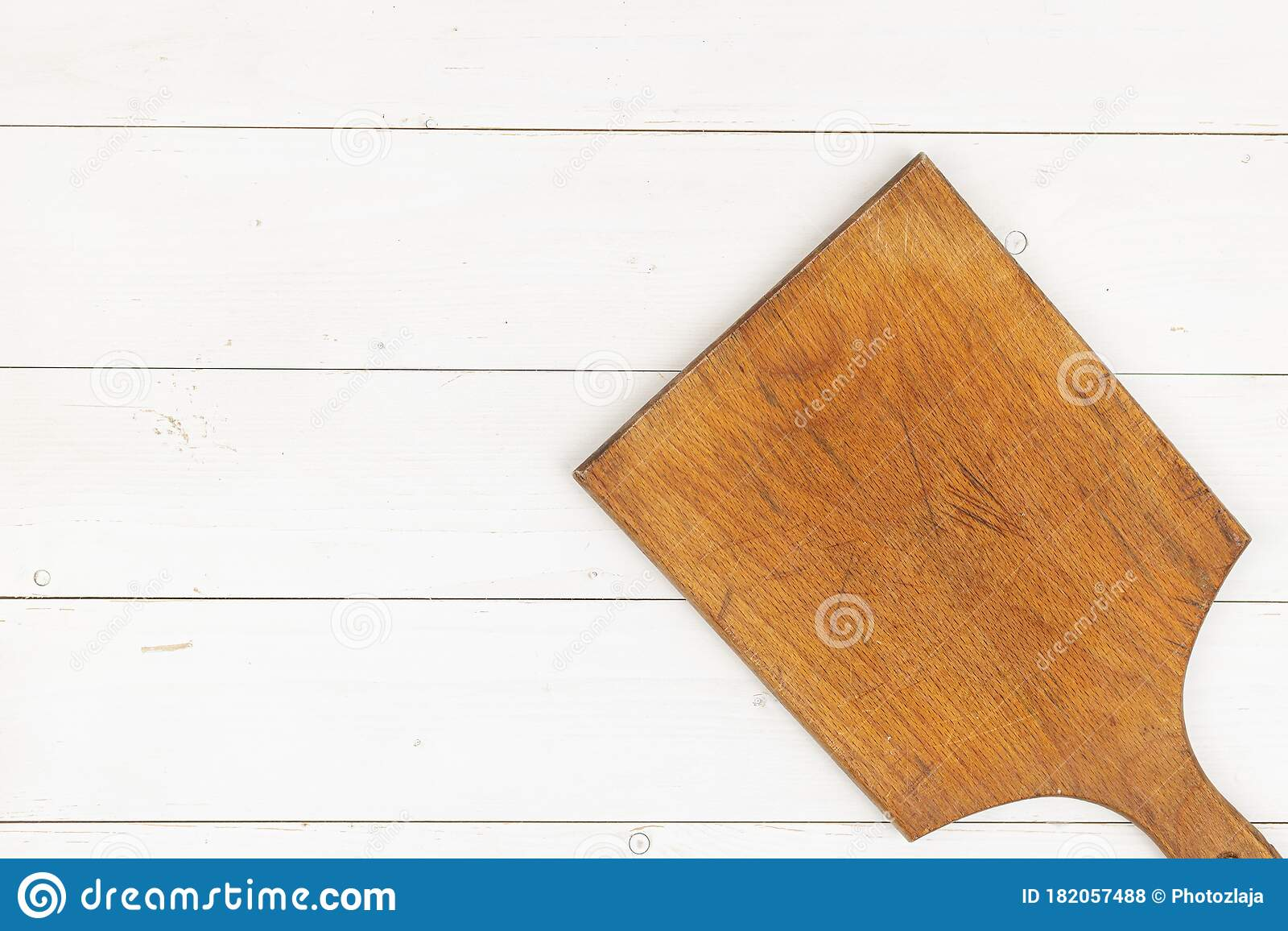 Old Wooden Rustic Cutting Board Above White Planks Background With Copy Space Stock Photo Image Of Wood Background 182057488