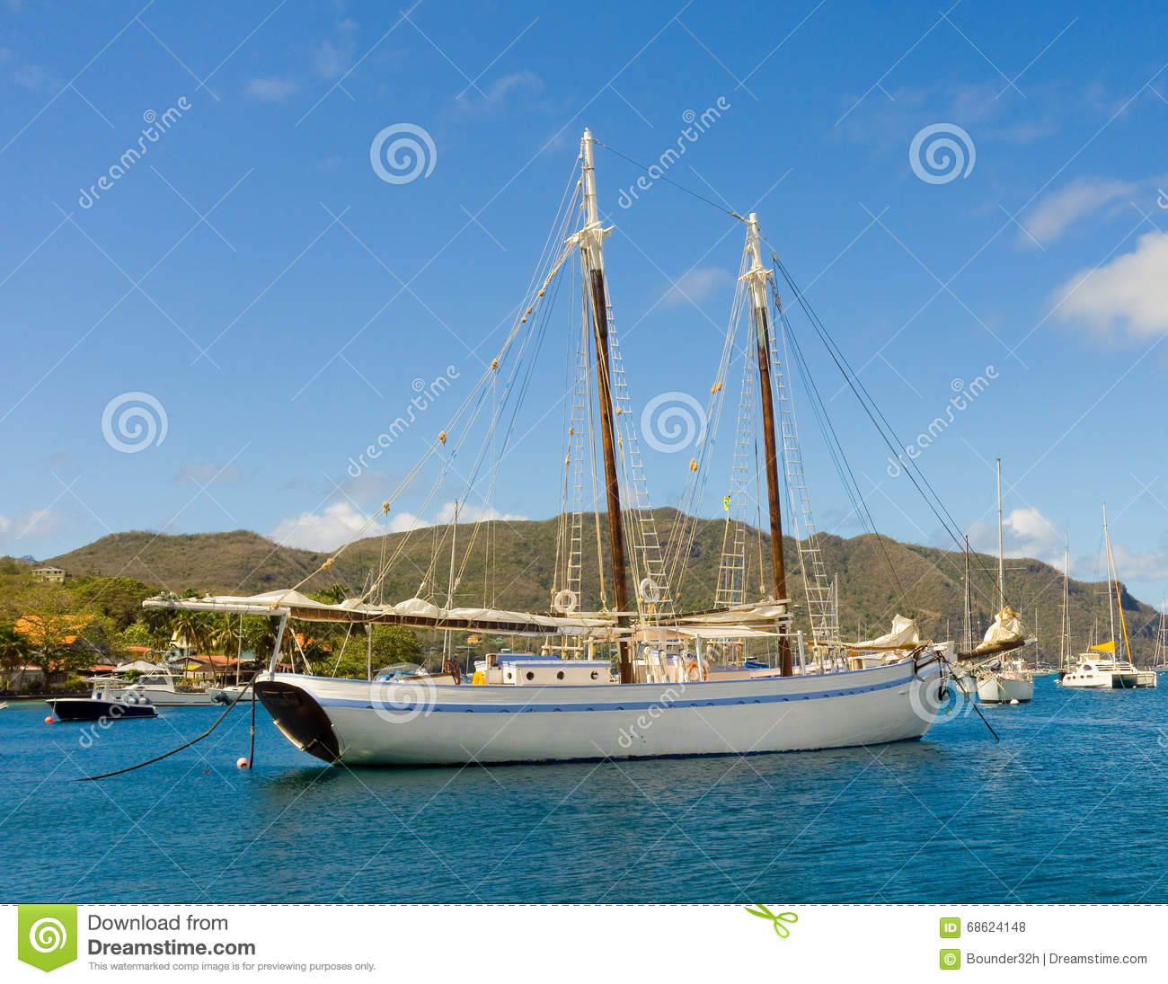 An Old Wooden Schooner At Anchor In The Windward Islands Stock Photo