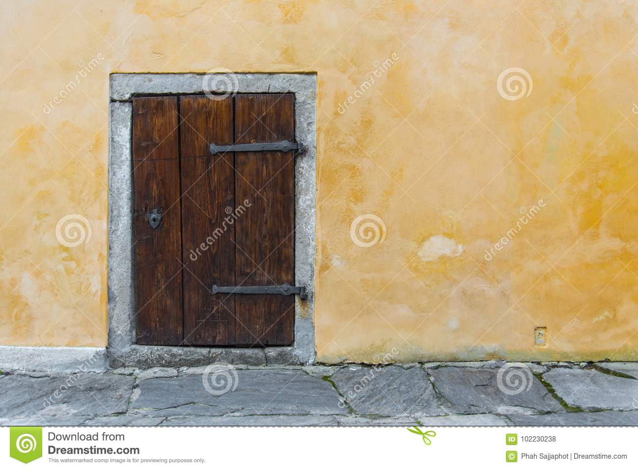 Old Wooden Small Door On The Yellow Rustic Wall Stock Photo - Image ...