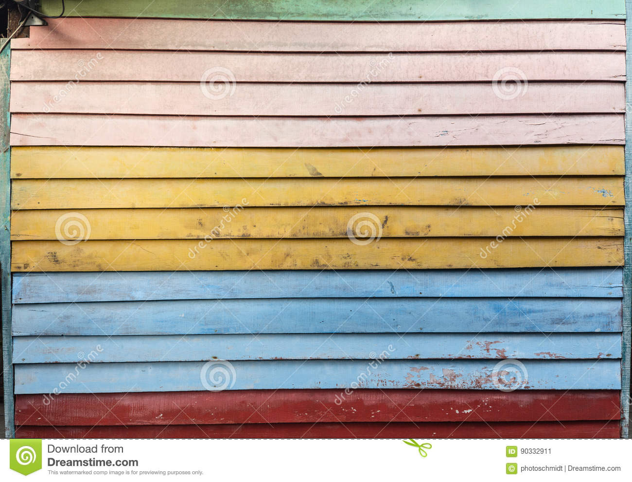 Old Wooden Wall Made Of Colorful Planks