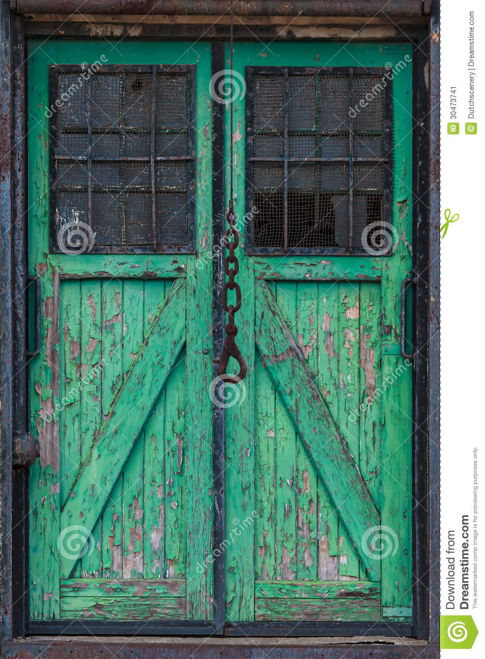 Old Wooden Warehouse Door With A Crane Hook In Front Stock