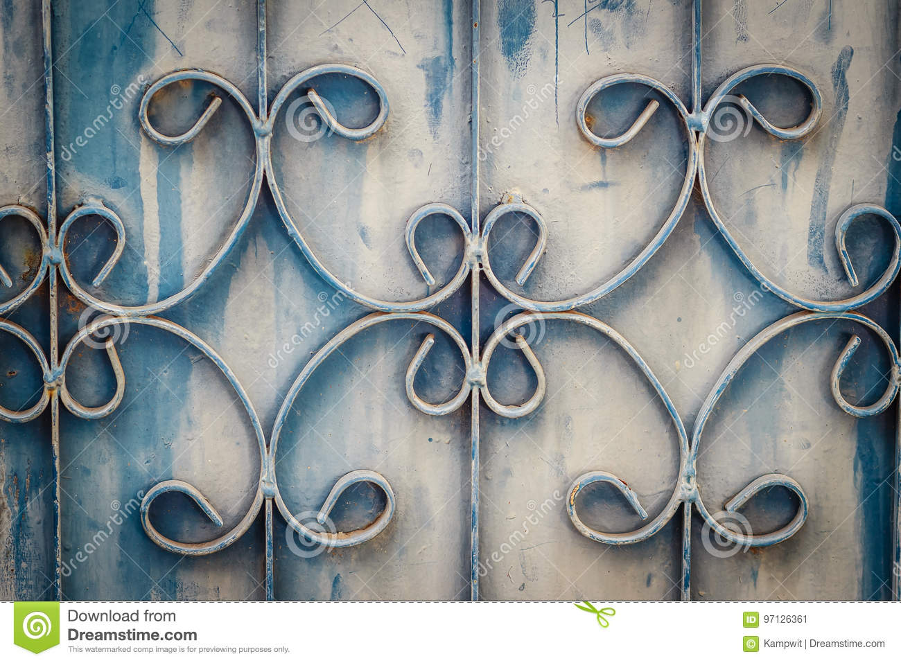 Old wrought iron bars on the gate with grunge and rusty steel b