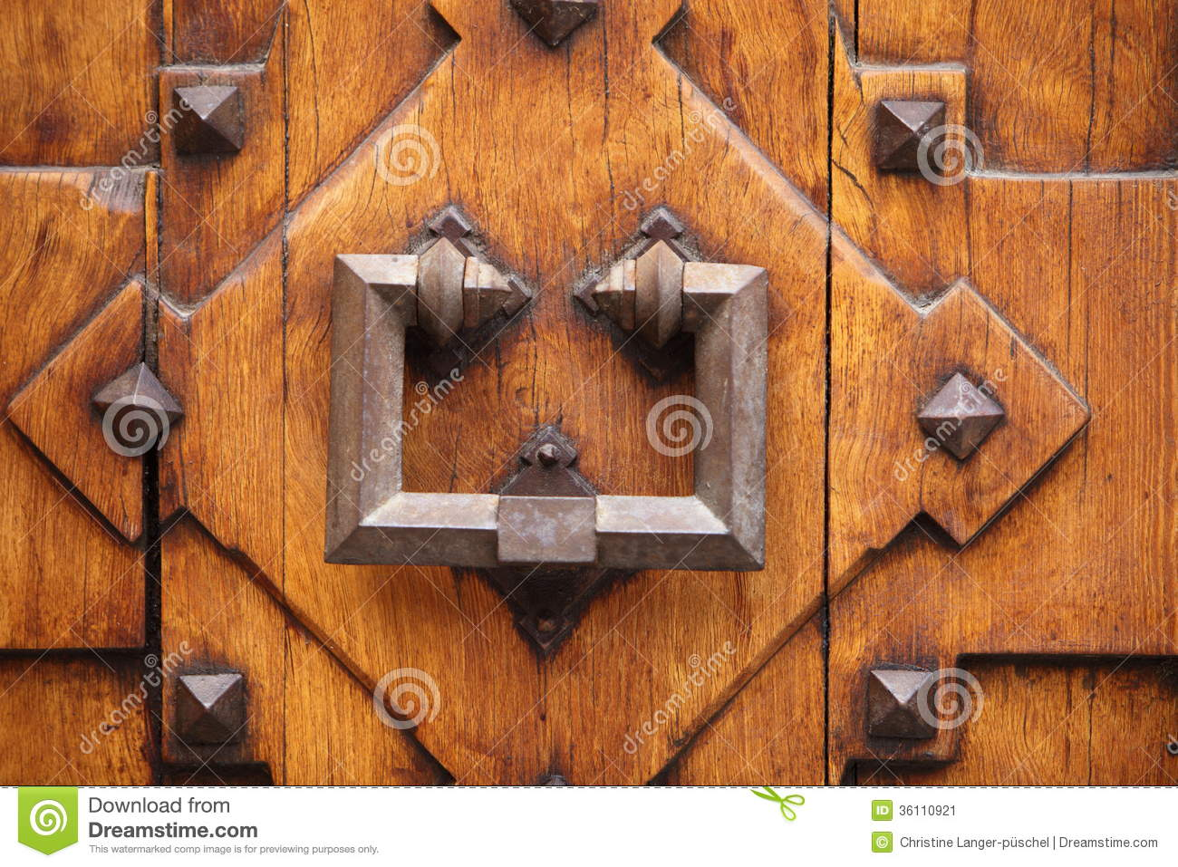 Old wrought iron door knocker stock image image 36110921 for Wood doors with wrought iron
