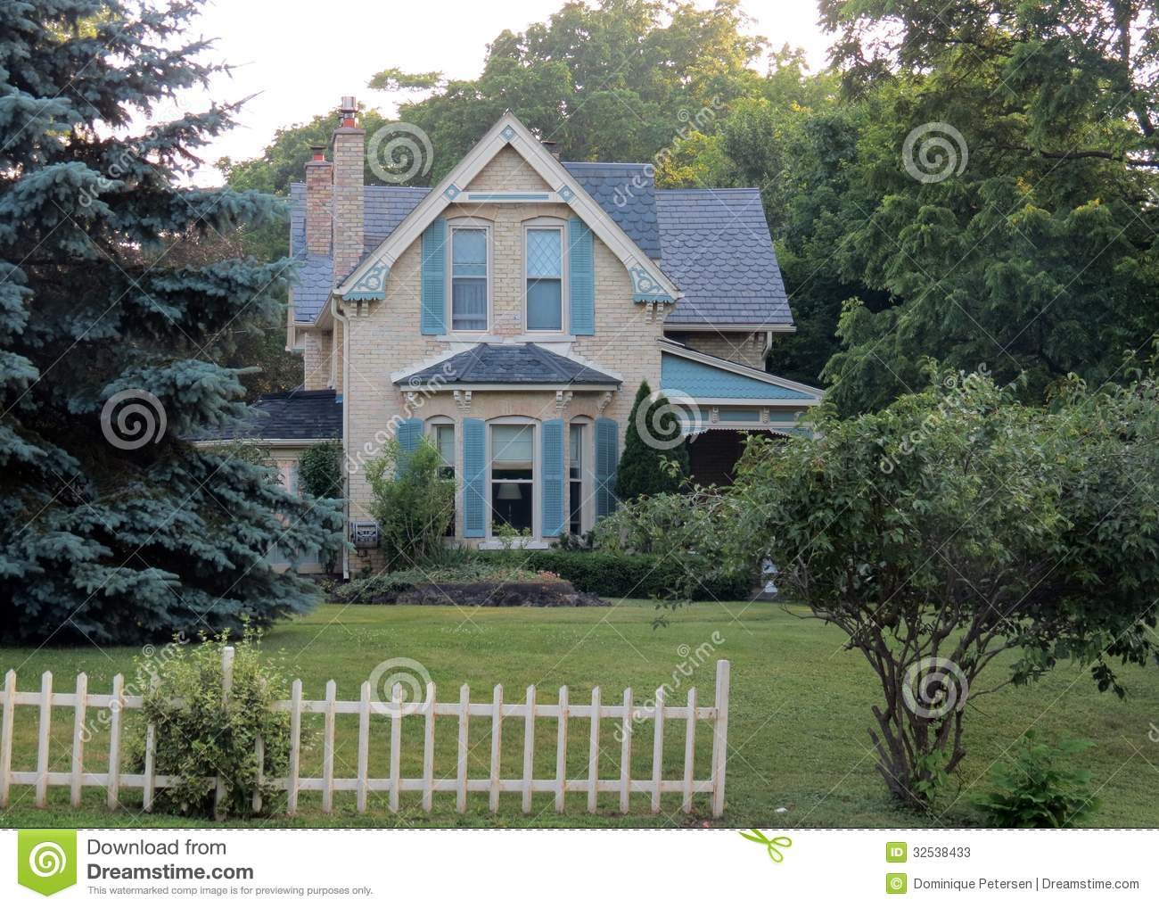 ... -story, Victorian-style home with large front yard and picket fence