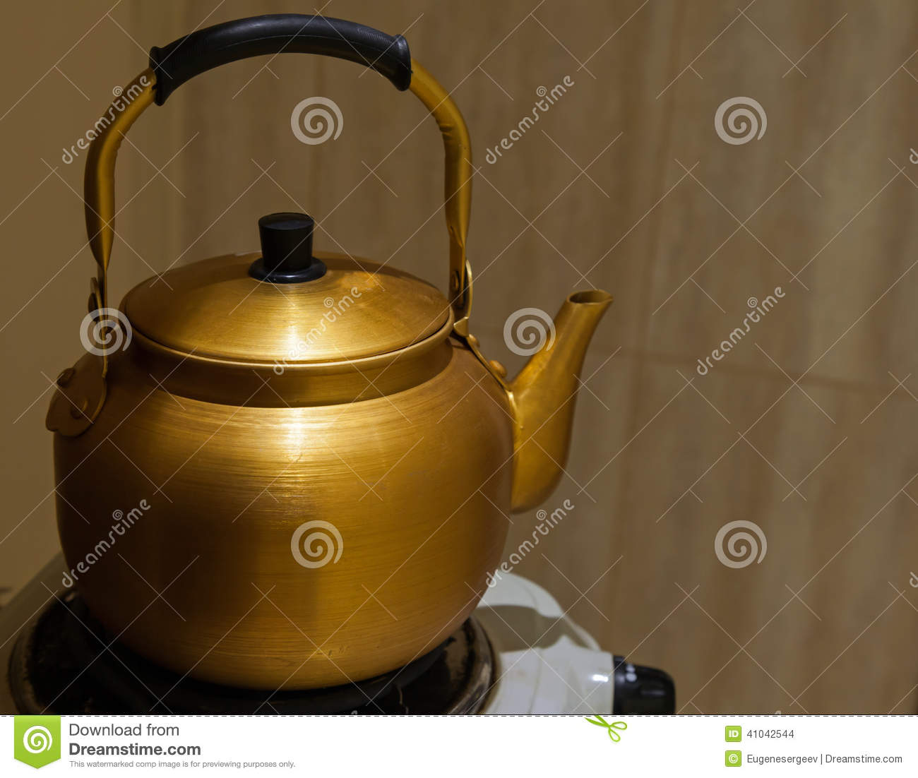 Old Yellow Metal Teapot On The Stove Stock Photo - Image: 41042544