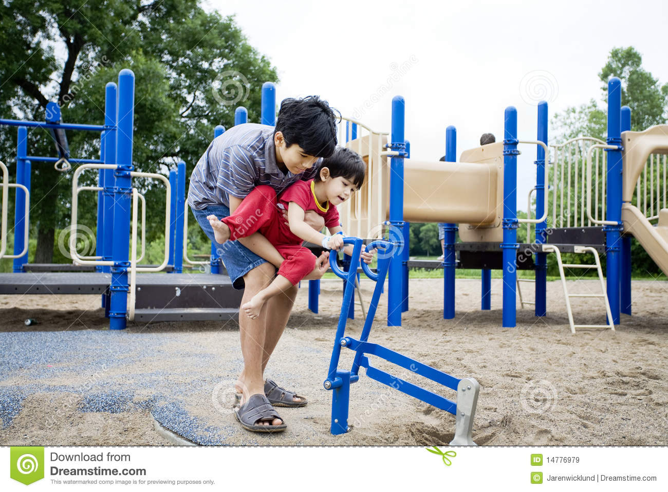 Older Brother Helping Disabled Sibling Royalty Free Stock