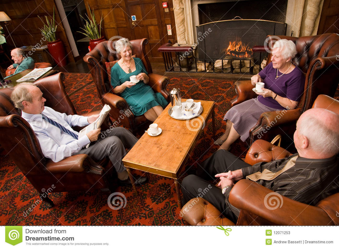Older Group Of Friends By Fireplace Stock Image Image