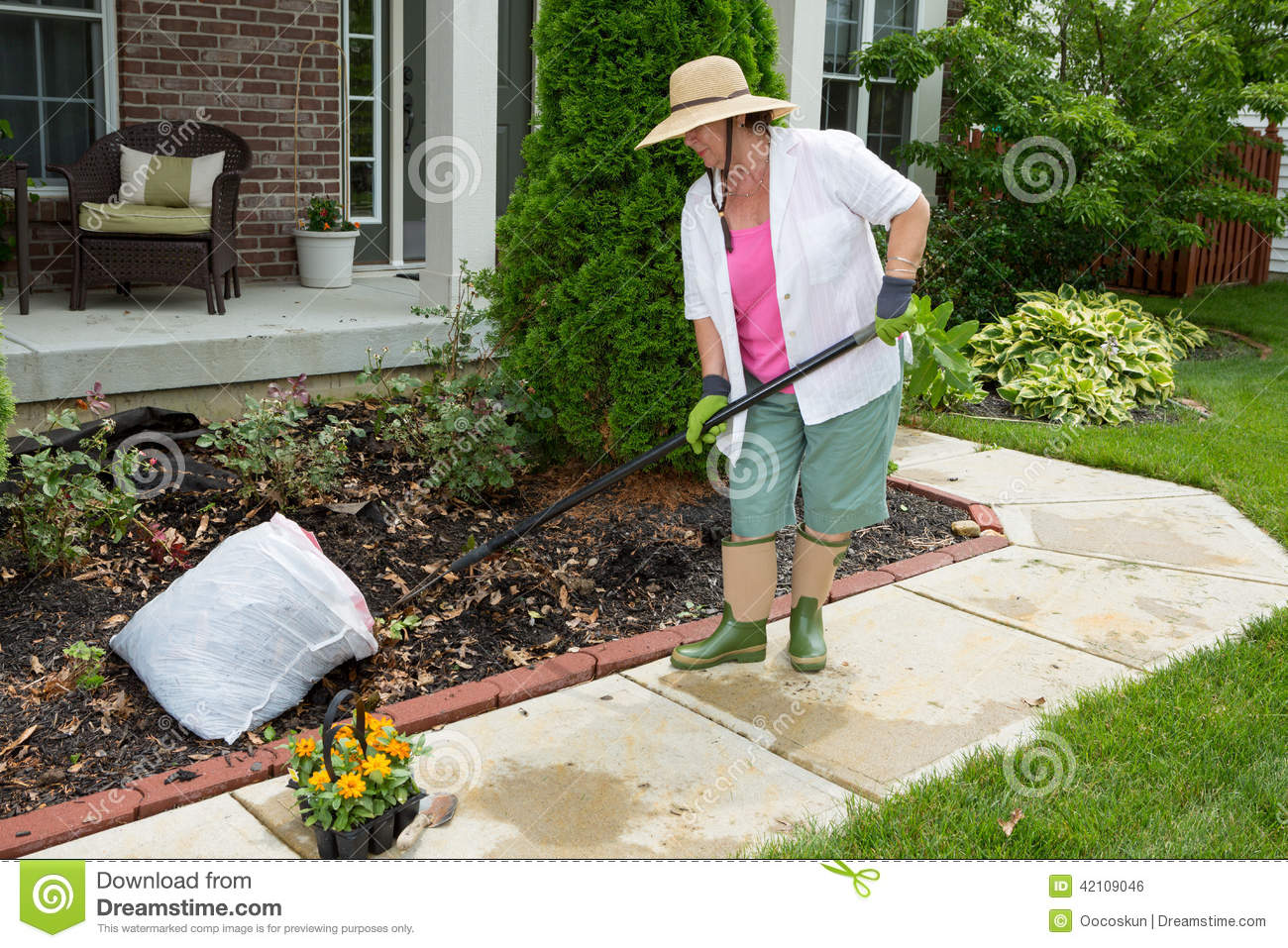 Older lady doing cleaning work in the yard stock photo for Garden design for disabled
