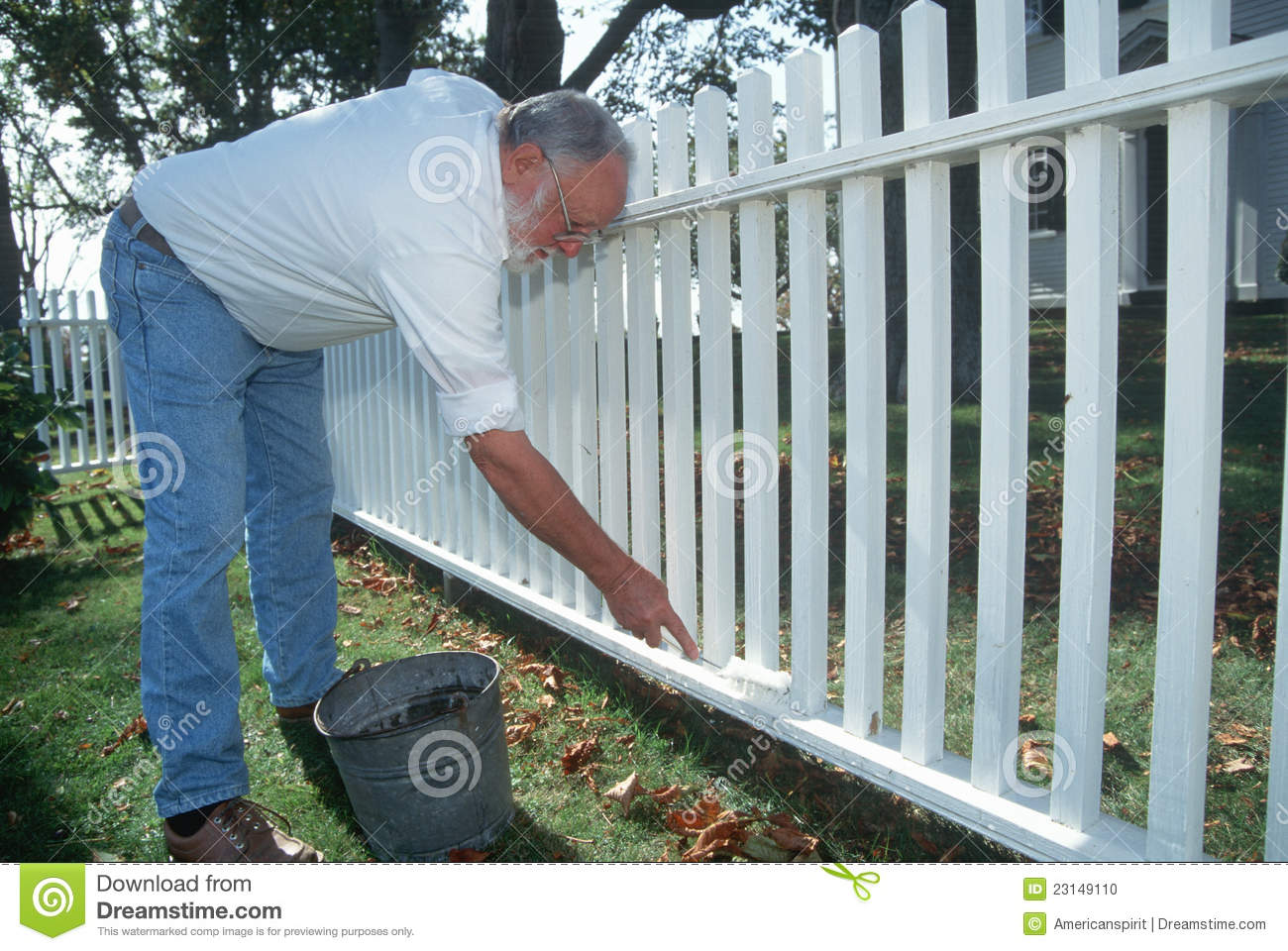 older-man-painting-white-picket-fence-23