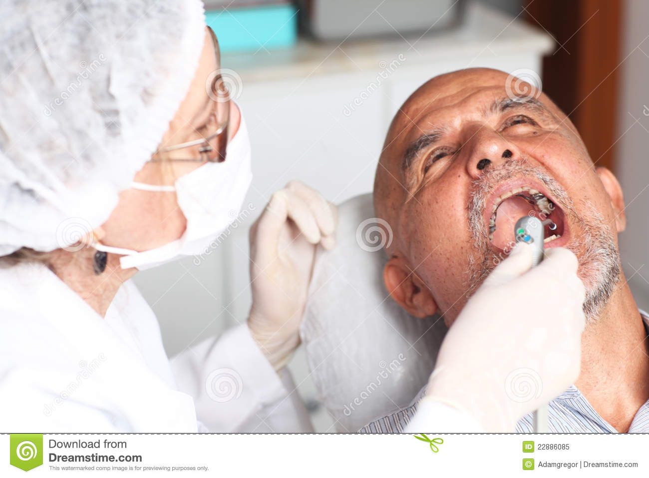 Older man with toothache at the dentist