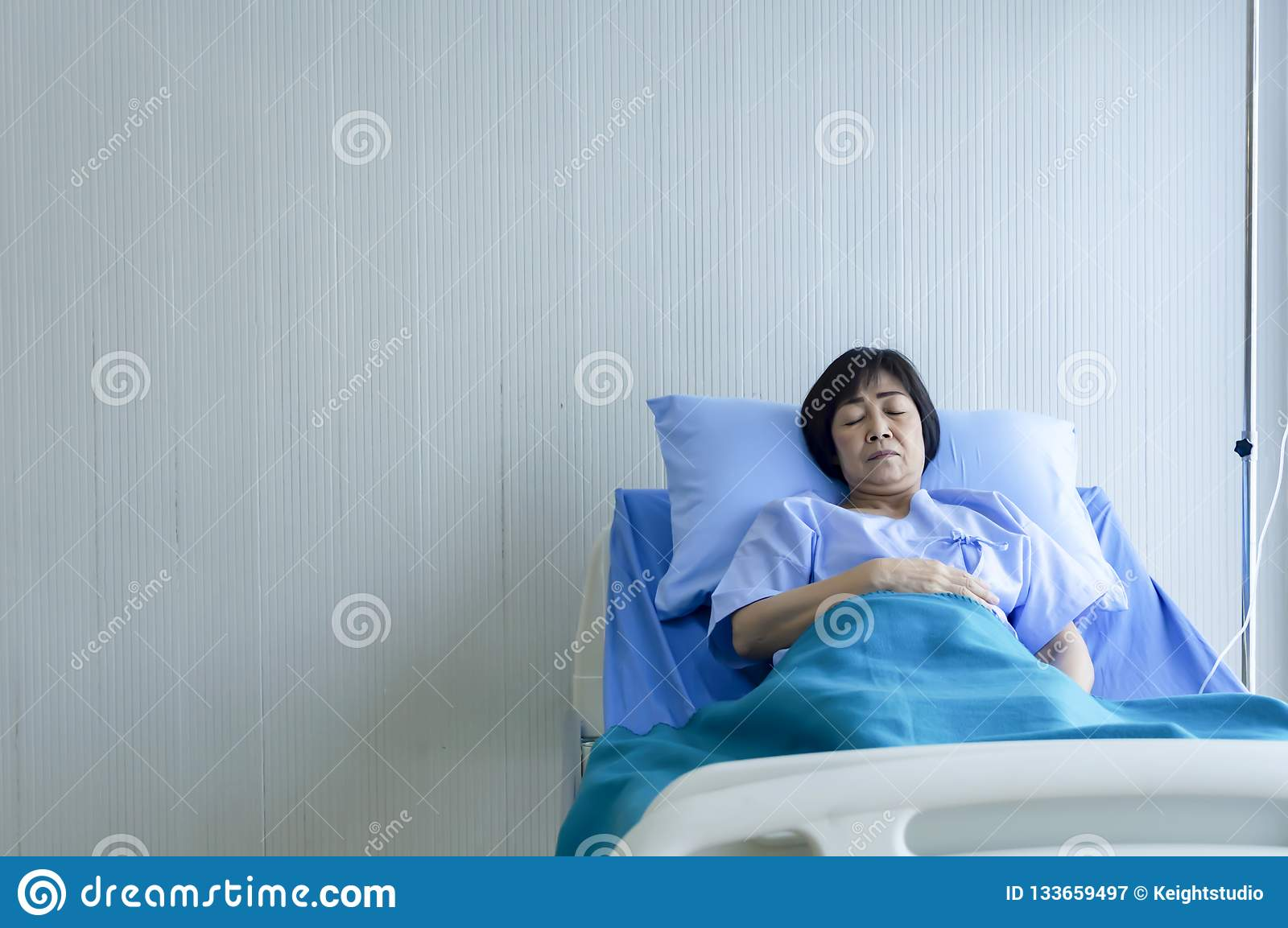 Older Sick Woman Patient Lay On Bed In Hospital With