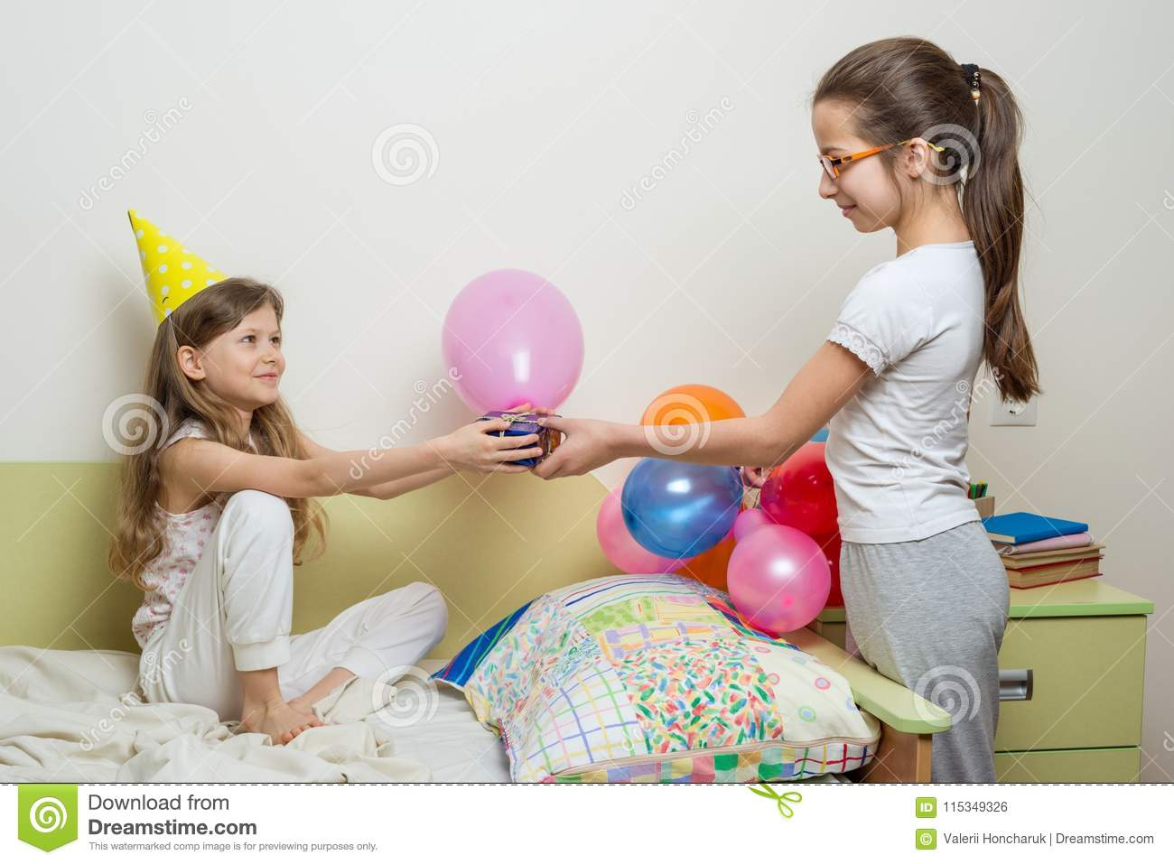 Older Sister Giving Surprise Gift To Her Cute Little