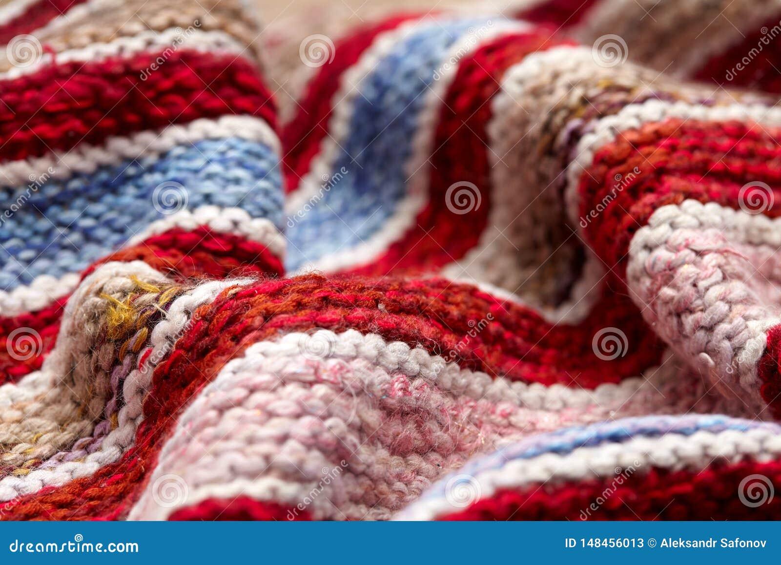 Olika kulöra band på den stack tygyttersidan bakgrundsnärbild av retro filtar för textiler eller filtar Texturen av