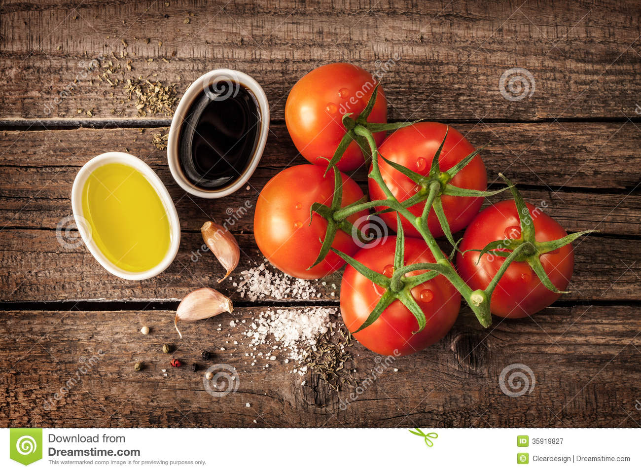 Vinaigrette or french dressing recipe ingredients and tomato branch on ...