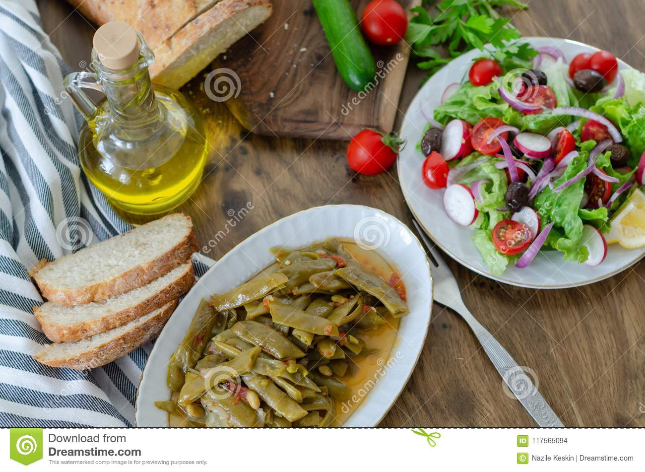 Healthy eating habits,Olive oil with bean meal and salad and