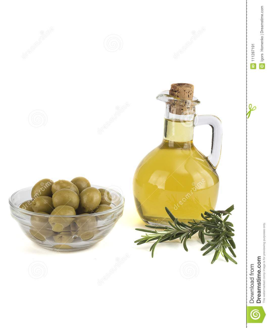 Olive Oil In A Bottle And Olives On A White Background