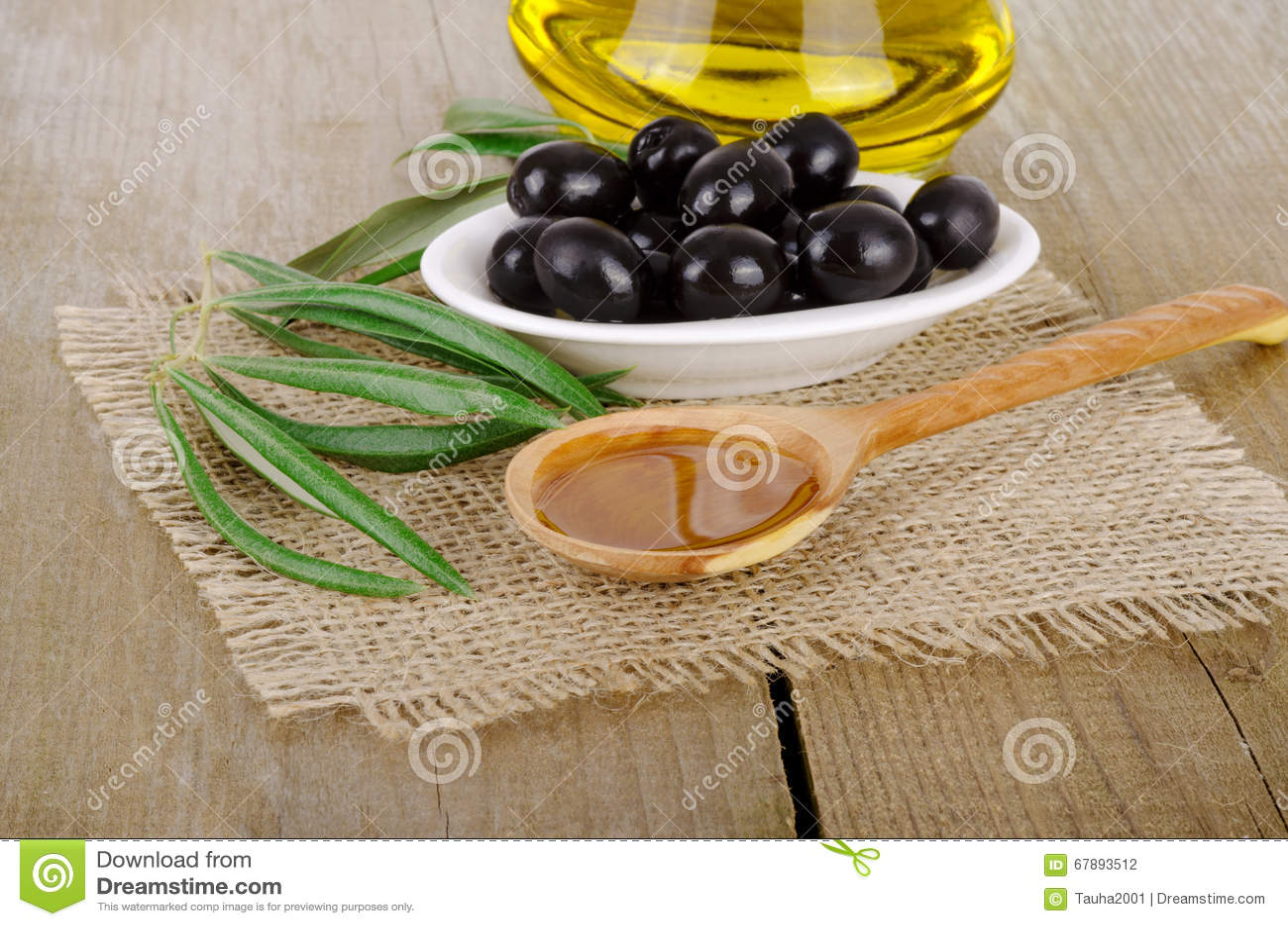 Olive Oil em um de madeira