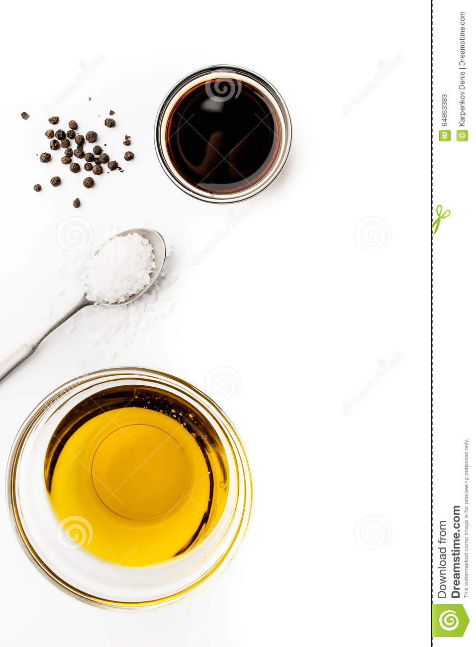Olive oil with seasoning on the white background vertical