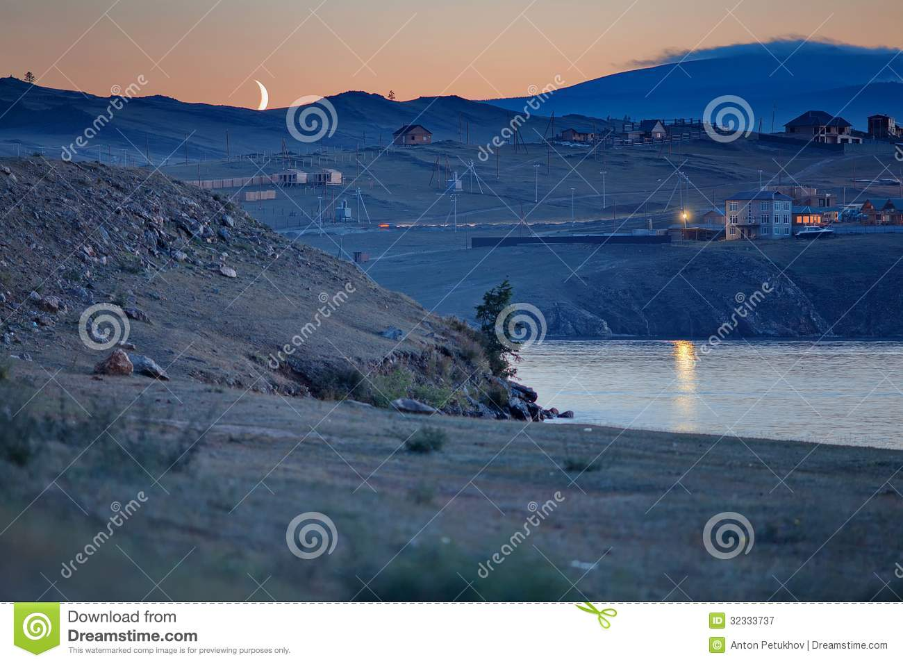 Scenic view of moon shining over Olkhon island at night, Lake Baikal ...